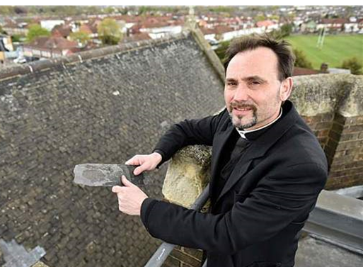 Fr Bates with slate slipped from the roof